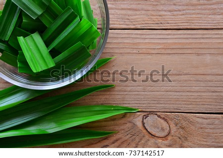 Pandanus on wooden background, top view #737142517