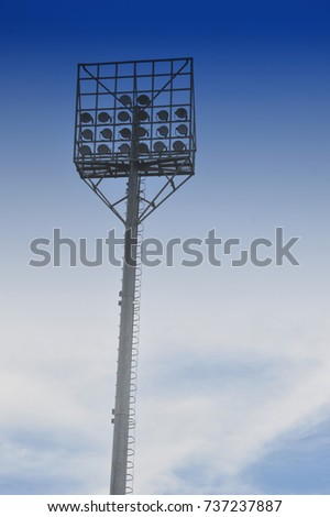 stadium light poles with white clouds and blue sky backgrounds #737237887