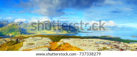 Sunny summer panorama on norway coastline. Lofoten rocks and mountains in soft sunlight. Sunny panoramic background. #737338279