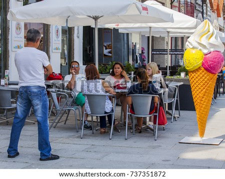 PORTO, PORTUGAL, on June 17, 2017. People eat and have a rest in cafe under the open sky in a historical part of the city.  #737351872