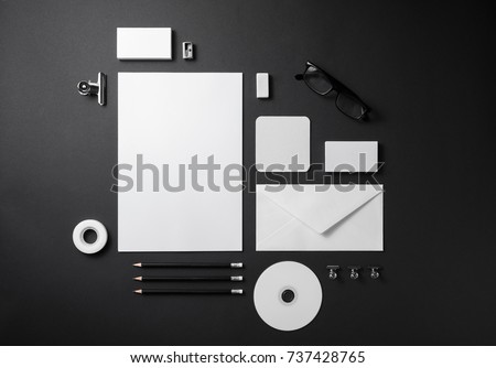 Blank stationery set on black paper background. Template for branding identity. For graphic designers presentations and portfolios. Top view.