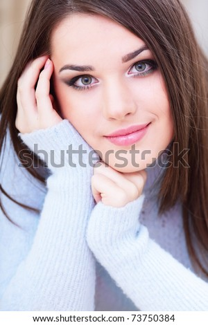 Portrait of a young cute woman in warm sweater #73750384