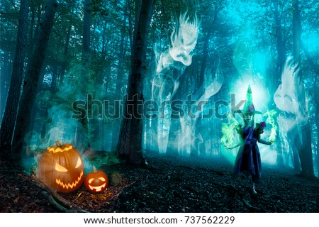 A witch with magic fire and spirits in a halloween forest.  #737562229