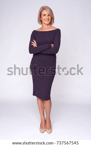 full length portrait of a fashionable old woman isolated on grey #737567545