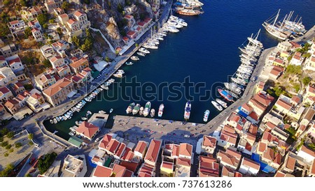 Aerial brid's eye photo taken by drone of Yalos, iconic port of Symi island, Dodecanese, Greece #737613286