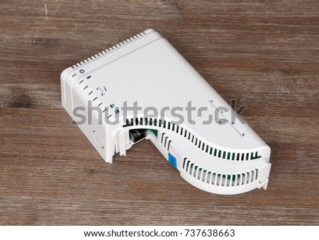 Simple home device for connecting the optic fiber - Wood table background #737638663