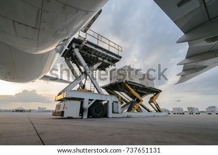 loading cargo outside cargo plane Royalty-Free Stock Photo #737651131