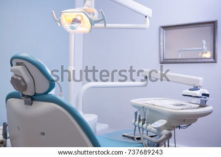 Chair and medical equipments at empty dental clinic #737689243