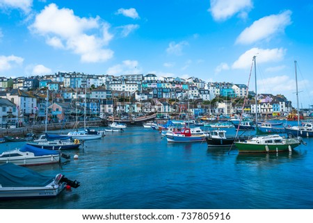 BRIXHAM, DEVON, UK - OCTOBER 16,2017: Brixham Harbour is located on the southern side of Tor Bay, it boasts one of the largest fishing fleets in the UK and a thriving fish market to support it. #737805916