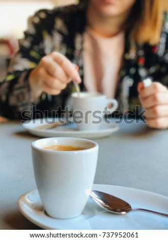 Young woman with a mug of coffee Royalty-Free Stock Photo #737952061