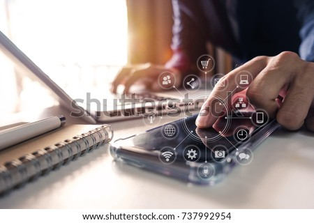 businessman hand working with finances about cost and calculator and laptop with tablet and smartphone on with desk in modern office in morning light.  #737992954