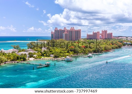 Paradise island with the Atlantis Resort at the background, Nassau, Bahamas Awesome Atlantis Resort on Paradise island in the island of Nassau, in the heart of the Caribbean sea in a sunny summer day. #737997469