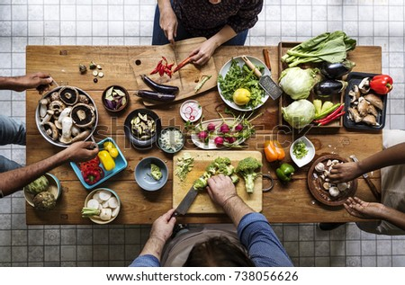 Aerial view of people with fresh organic vegetable preparing to cook #738056626