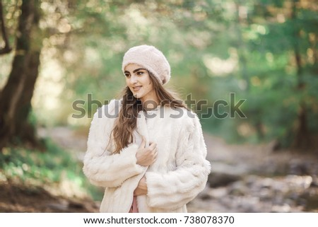 beautiful girl stands beside the mountain stream #738078370