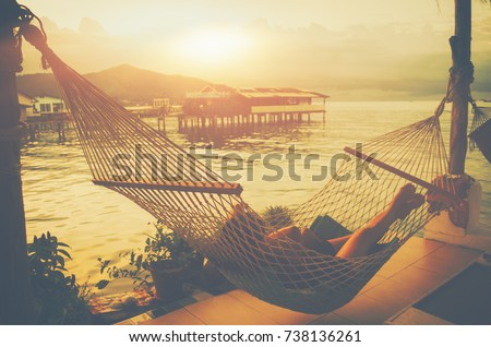 Lady sleep enjoying hammock tropical beach Home stay Resting place Fishing village sunset Beautiful summer vacations outdoor harmony nature Travel Lifestyle relaxation emotional concept of Bangsaray  #738136261