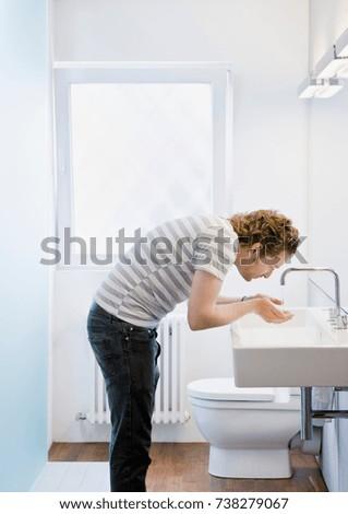 Man washing his face #738279067