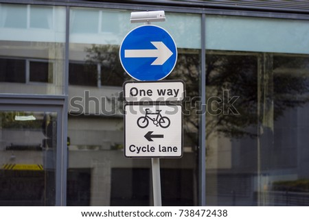 A one way street sign in London with cycle lane running in opposite direction