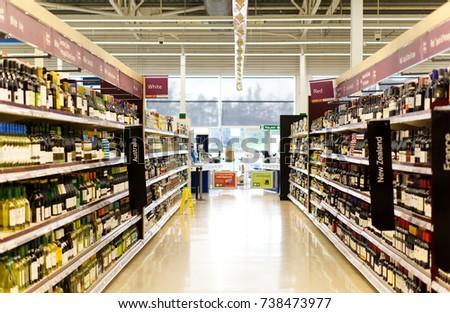 BATHGATE, SCOTLAND, UK - OCTOBER 11, 2017. Tesco supermarket aisle, empty of shoppers. #738473977