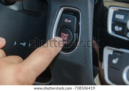 Close up Finger press button functions car engine start and stop motor vehicle for pre start checklist concept.  #738506419