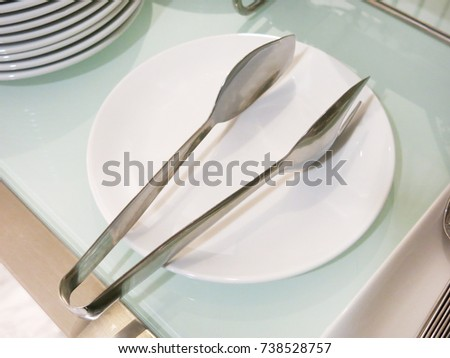 crusine tool on white plate. #738528757