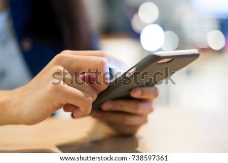 Using cellphone in coffee shop  #738597361