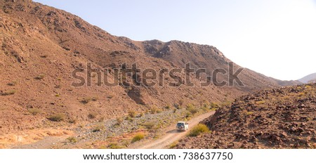Offroad and hiking in the mountains near Hatta, UAE, near the border of Oman #738637750