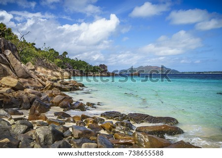 A lot of granite rocks, turquoise water and a steep coast on seychelles beach. #738655588