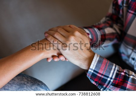 Man and woman holding hands closeup #738812608