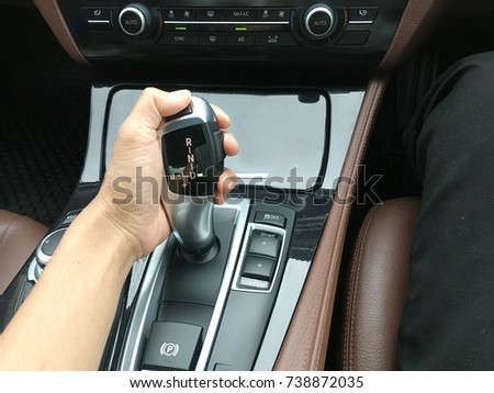 Driver hand on automatic gear shift at D mode in luxury car #738872035