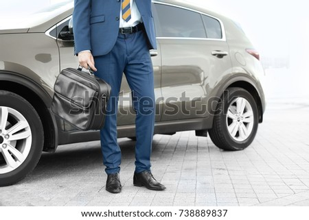 Successful businessman near car outdoors #738889837