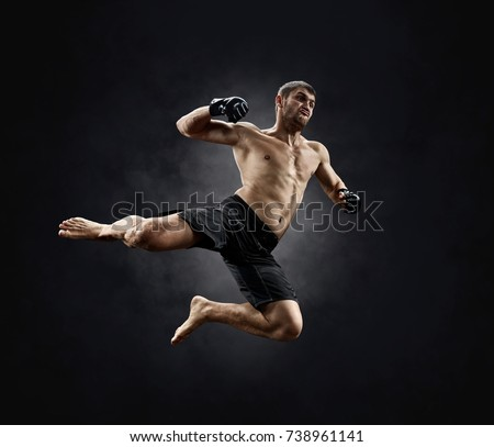 mma female fighter celebrating win Royalty-Free Stock Photo #738961141