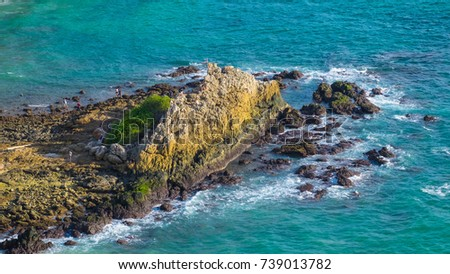 Huge Stone and Turquoise Color of Sea with waves from wind, Phuket, Thaialnd.  #739013782