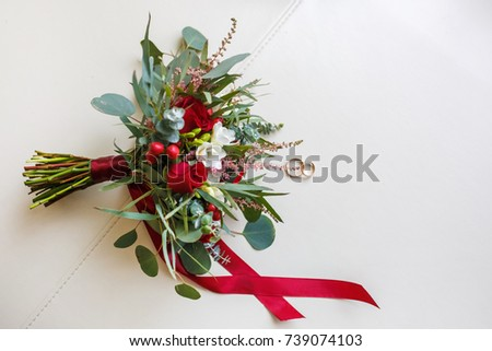 Wedding  beautiful bouquet of light several red and white color roses flowers with rings #739074103