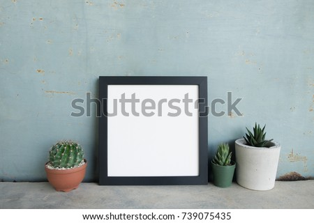 Square frame poster with succulent plant in pot on concrete floor and metal wall. Retro style
