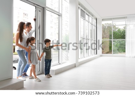 Happy family entering new house #739102573