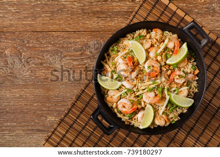 Fried rice with shrimp in Thai. Prepared in wok. Top view. #739180297