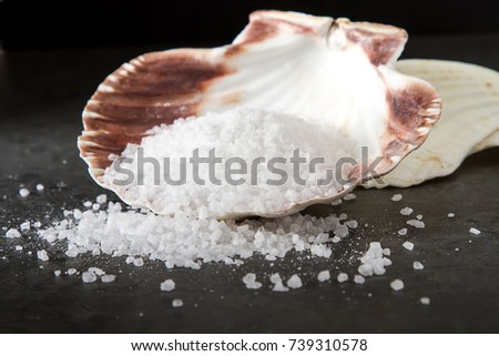 Sea salt. Dark background. Spa treatments #739310578