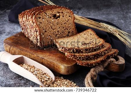 Sliced rye bread on cutting board. Whole grain rye bread with seeds #739346722