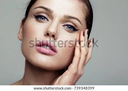 close-up beauty shot of young pretty model with bright make-up. Eyeliner.  Royalty-Free Stock Photo #739348399