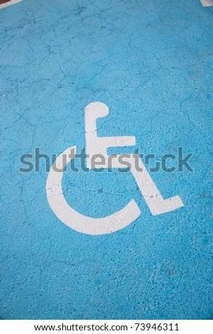 only handicapped parking sign on the asphalt ground #73946311