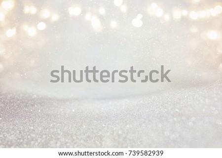 glitter vintage lights background. silver and light gold. de-focused #739582939
