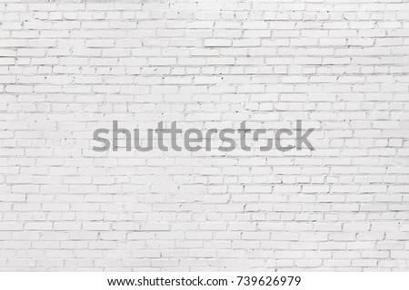 white brick wall, texture of whitened masonry as a background #739626979