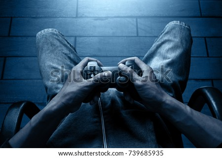 Playing video games Royalty-Free Stock Photo #739685935