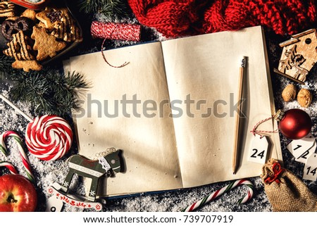 From above shot of cookies composed with blank book and Christmas decor on table. #739707919