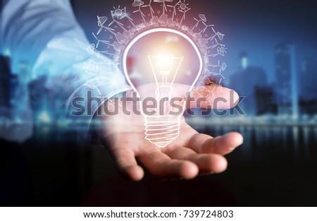 Businessman on blurred background holding renewable eco lightbulb sketch #739724803