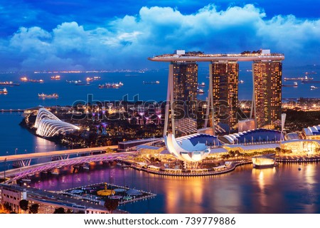 Singapore cityscape at dusk. Landscape of Singapore business building around Marina bay. Modern high building in business district area at twilight. Royalty-Free Stock Photo #739779886