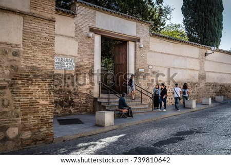 Toledo, Spain - October 13, 2017: Outdoor view of Santa Maria la Blanca Synagogue. It was constructed under the Christian Kingdom of Castile by Islamic architects. #739810642