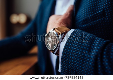 man with a watch #739834165