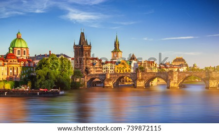 Scenic spring sunset aerial view of the Old Town pier architecture and Charles Bridge over Vltava river in Prague, Czech Republic Royalty-Free Stock Photo #739872115