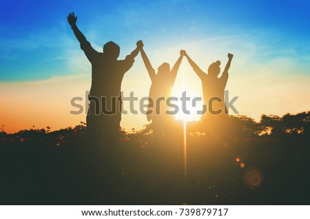 Silhouette of happy success positive teamwork hold hands up as business successful, business victory & celebrate achievement. Accomplish people merger & acquisitions concept. Royalty-Free Stock Photo #739879717